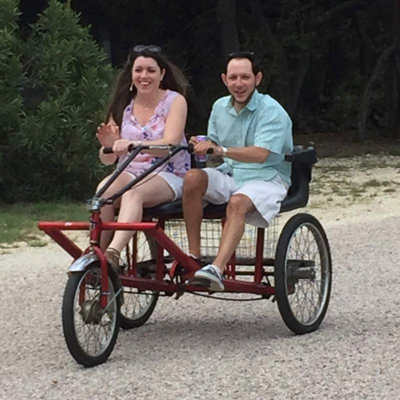 Bicycling on the property on a trike built for two.